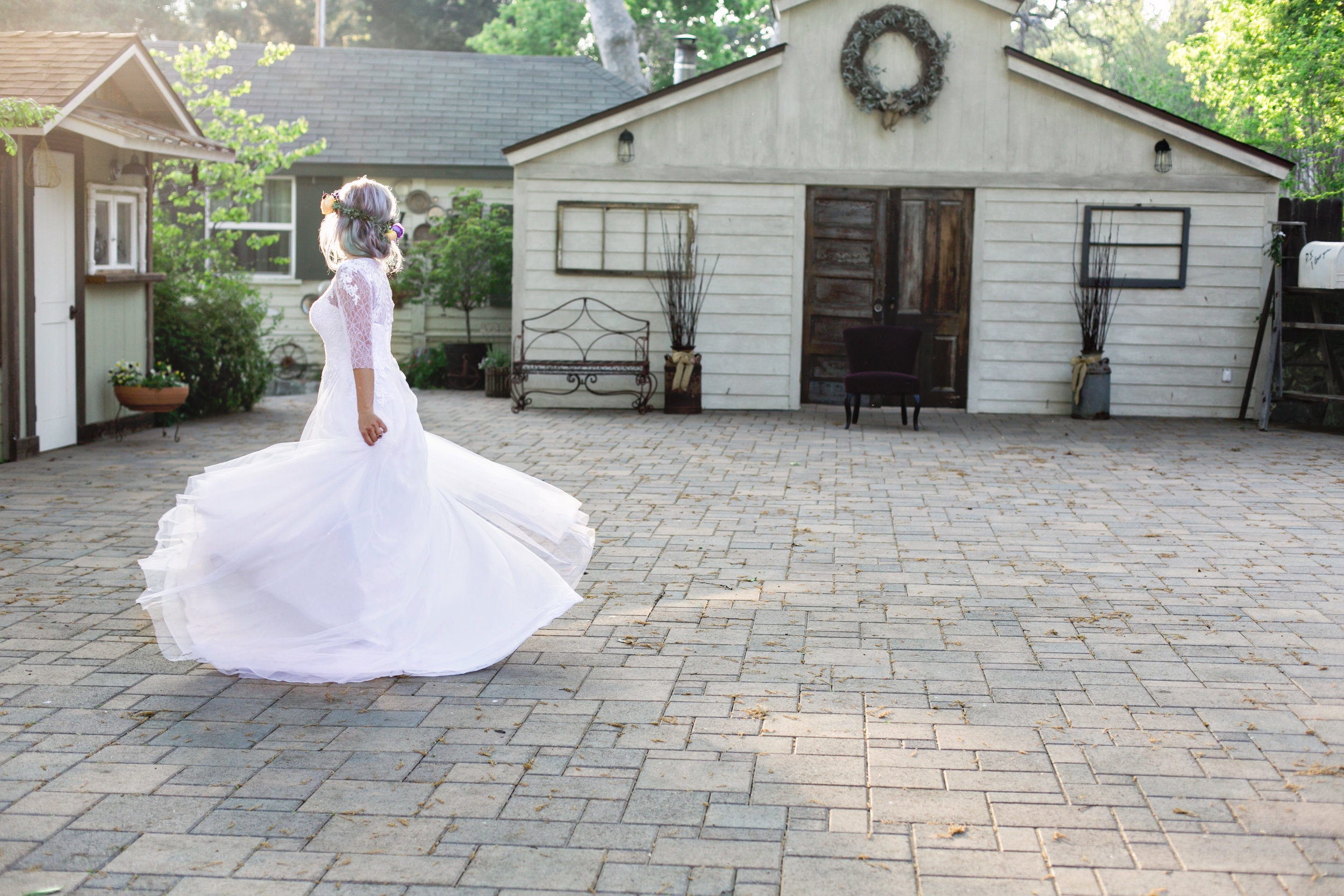 Lavender inspired wedding bride dancing at the Homestead at wilshire ranch in oak Glen, Ca carrie vines photography