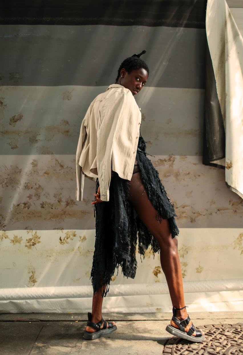 Dress: VIDEMUSOMNIA | Shirt: Stylist's own | Sandal: Doc Martens