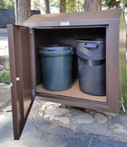 our LC-232a enclosure is designed to hold TWO Round 30-GALLON trash cans or ONE Round 32-Gallon and ONE ROUND 30-Gallon trash cans with space inside for a couple recycling bags.  -