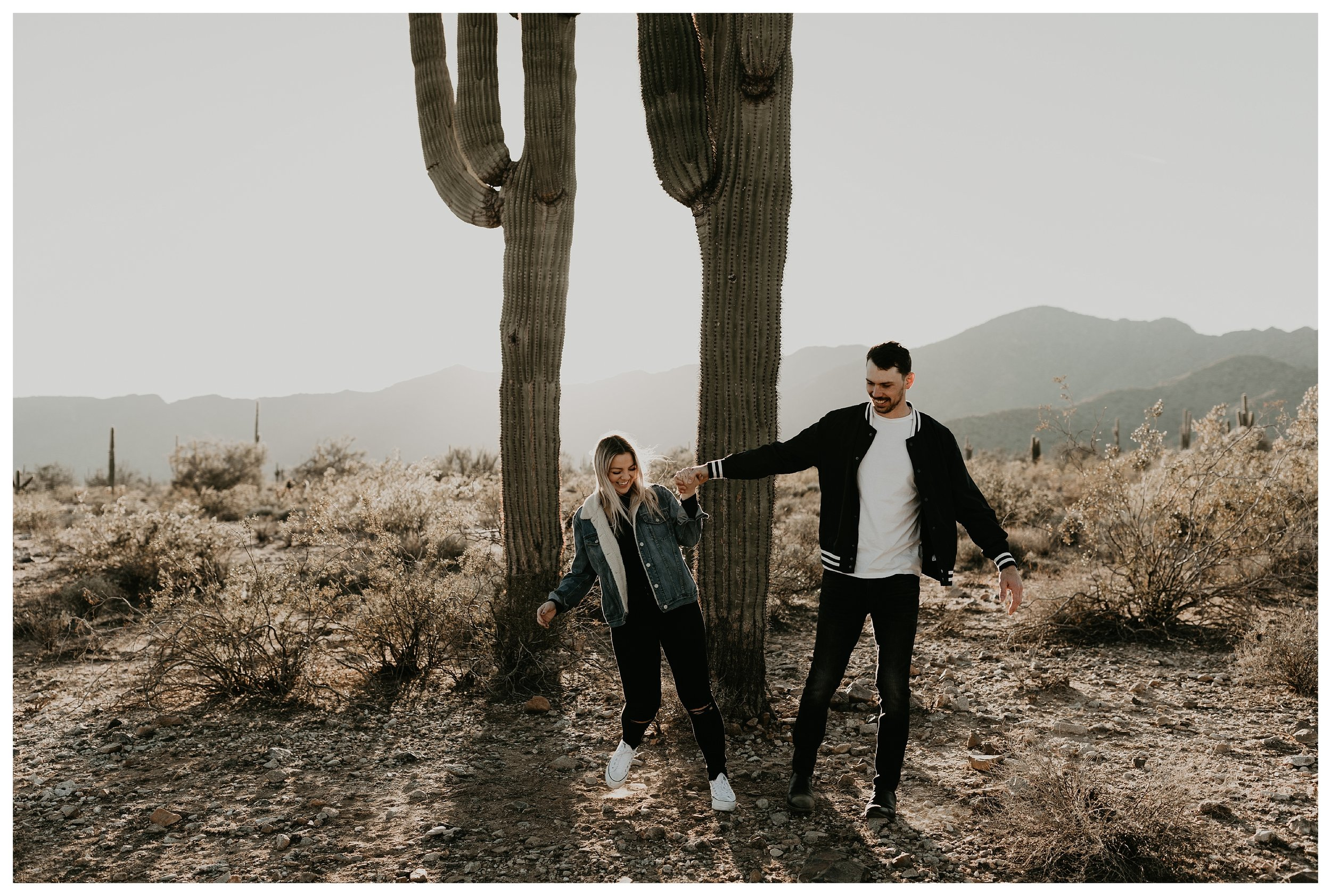 White tank engagement photos with mountains and cacti
