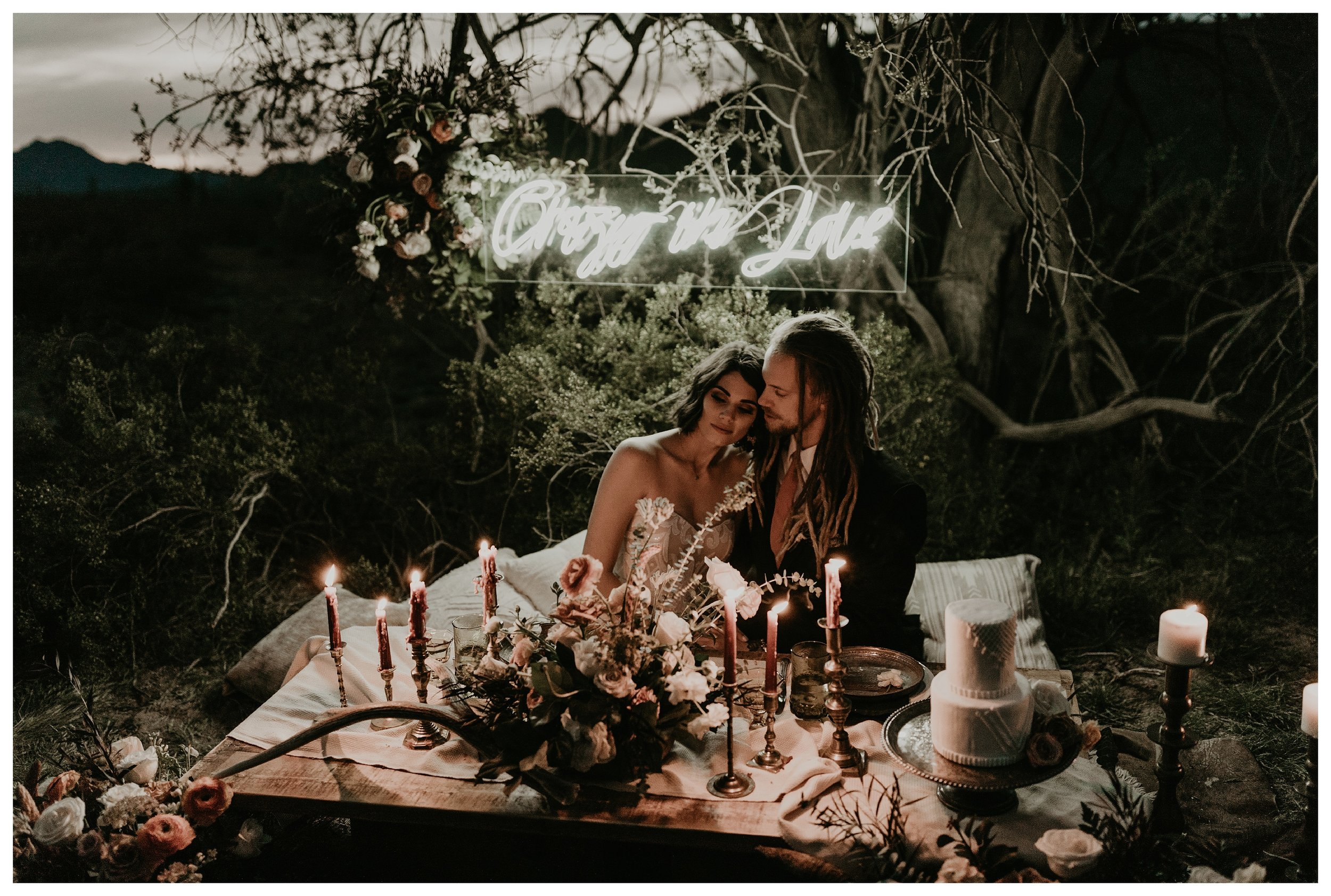 edgy bohemian desert elopement sweetheart inspiration with a neon sign and candles