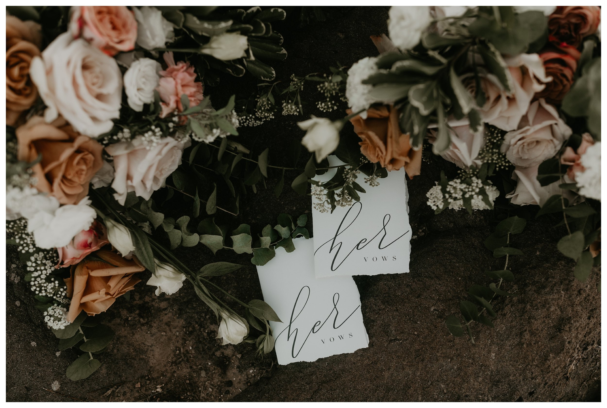 her wedding vow books with light pink and tan florals