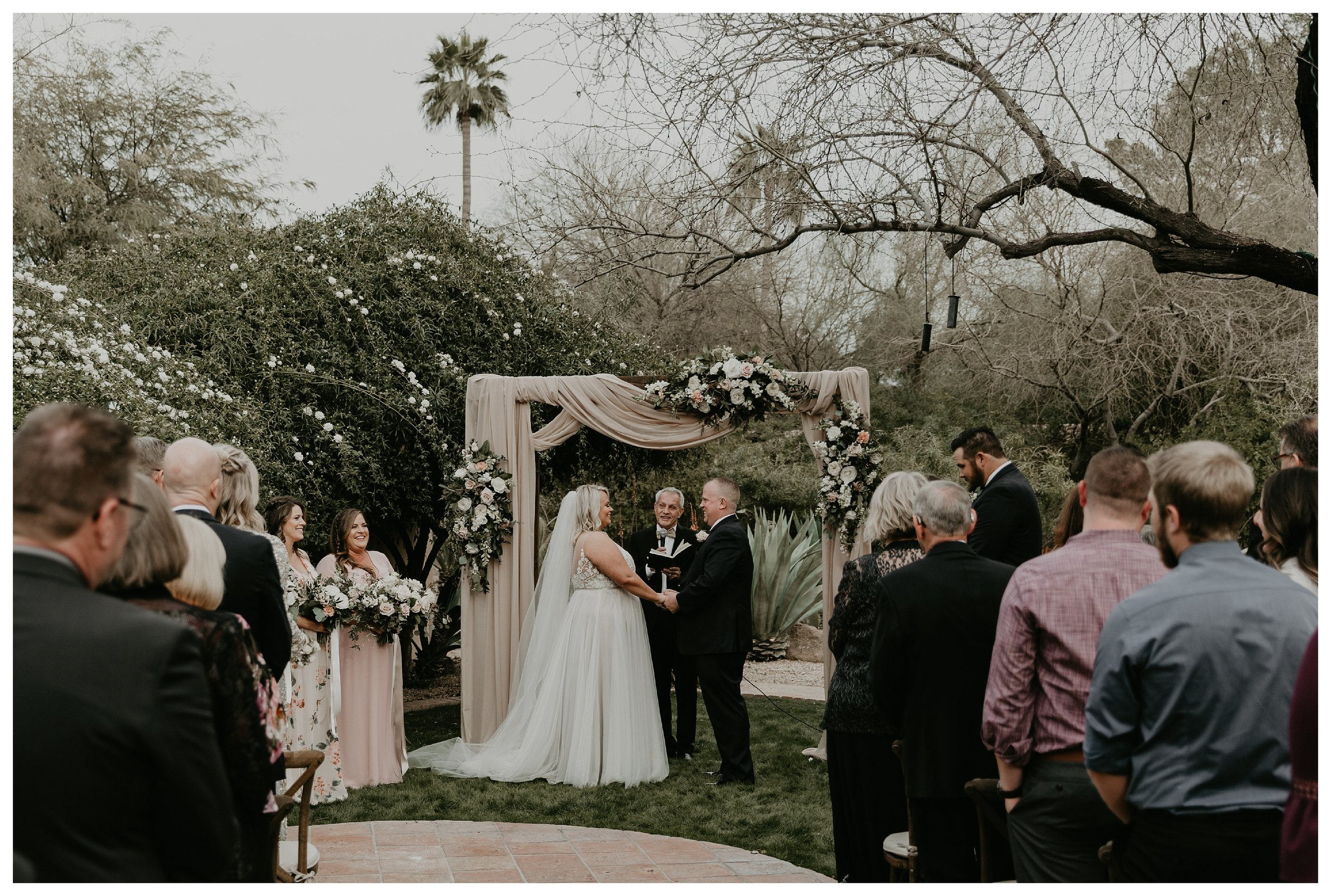 Hermosa Inn wedding intimate ceremony with greenery and floral arch install