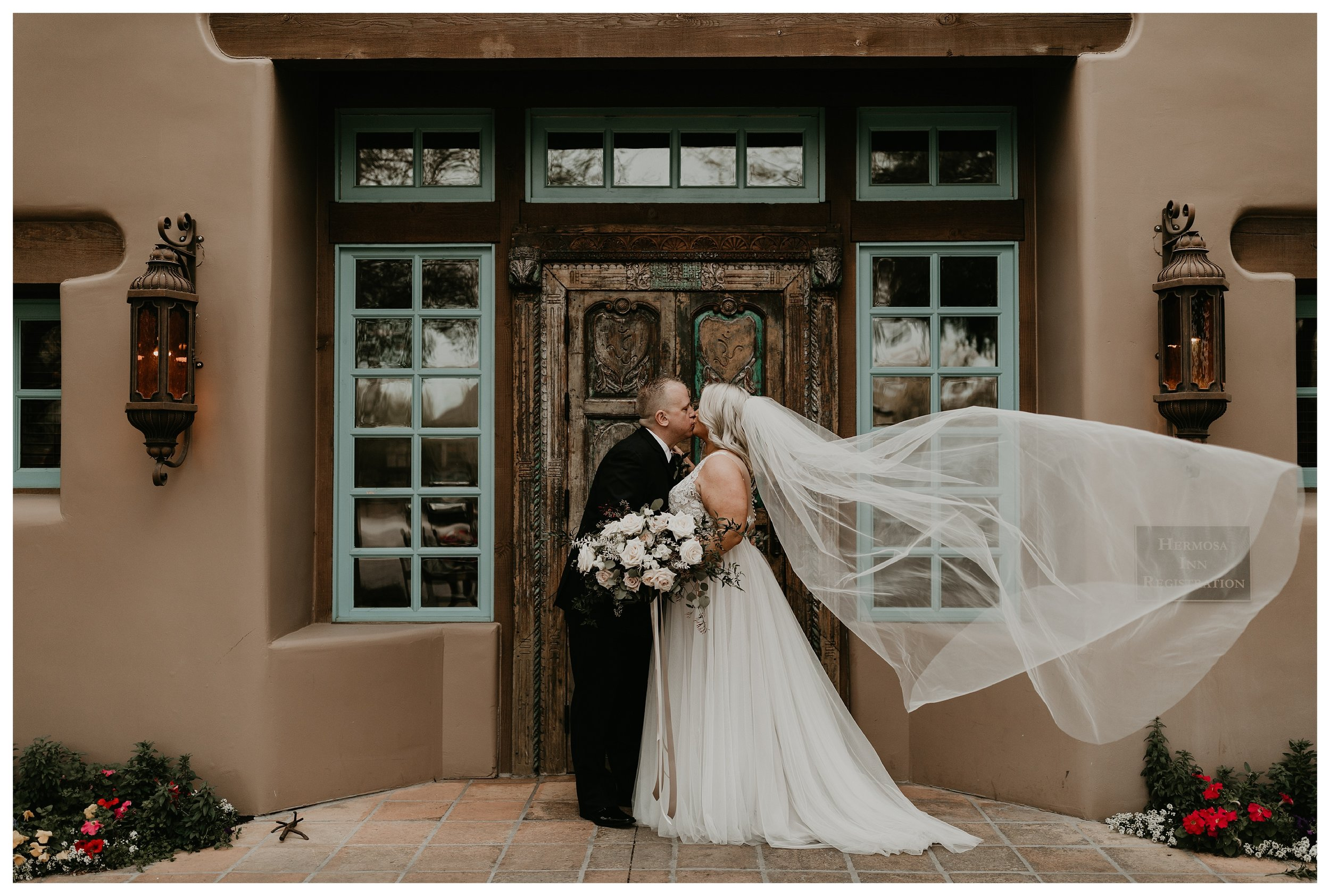 Bride and groom photos at Hermosa Inn in Arizona with long veil and white and greenery bouquet