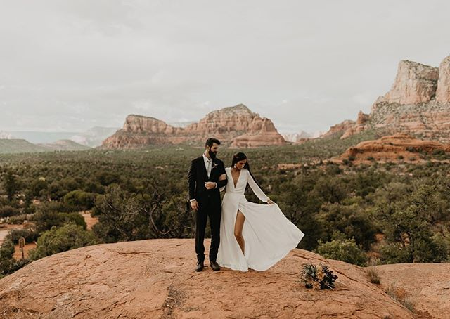 Sedona elopements have my HEART. So much planning went into this day & it 1000% paid off. Thank you so much to Sharda + Zeke for choosing me to capture your day. They both showed up saying how nervous & awkward they were infront of a camera & then we created THIS magic. My couples are so 🔥. — Photographer: @kalimphotos Video: @thehardins Makeup & hair: @thehouseoflo Florals: @fosterwrightfloraldesign Dress: @reformation