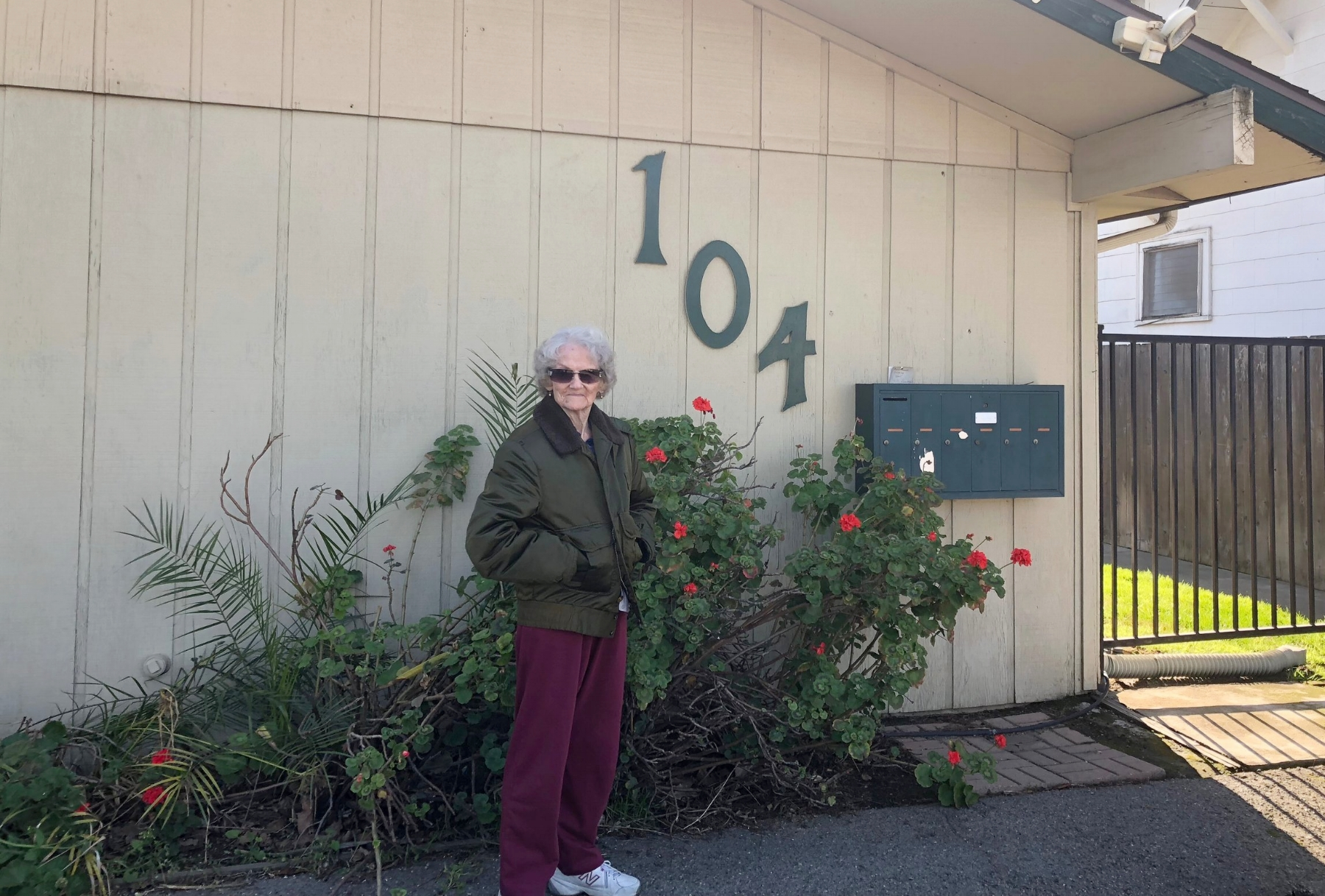 Della stands out front of her home from the LOEL Senior Housing