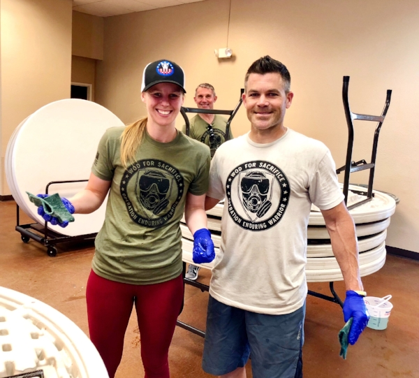 """""""We did Love Lodi last year. It's nice to give back. We had our holiday party here (at LOEL) so we wanted to give back to something we use."""" Pure Form PFT of Lodi scrubbing down tables at LOEL Senior Center."""