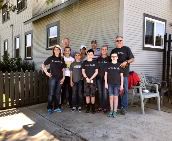 """""""We like to be a part of the community and help out. It's a good lesson for the kids. Lodi House does a great thing for women and children and we're happy to be able to help."""" Lodi City Employees and their families helping Lodi House clear out their basement."""