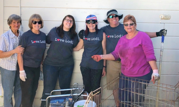 """""""We've been part of Love Lodi since its inception. We have a professional painter in our congregation, so when this project came up we jumped on it."""" Emanuel Luthern Church giving painting the outside of Animal Friends Connection Humane Society."""