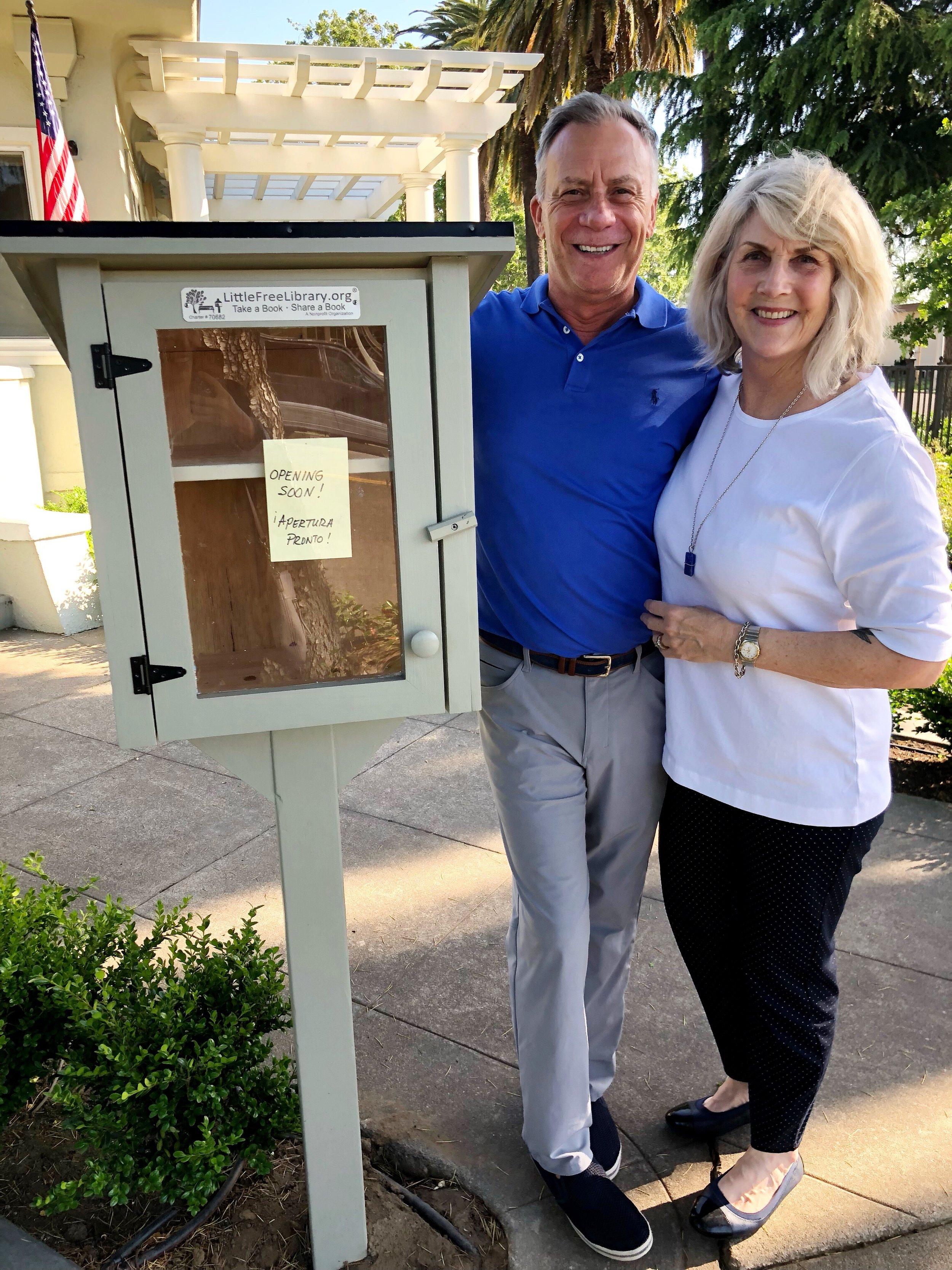 Dave & Virginia Marken next to their Little Free Library
