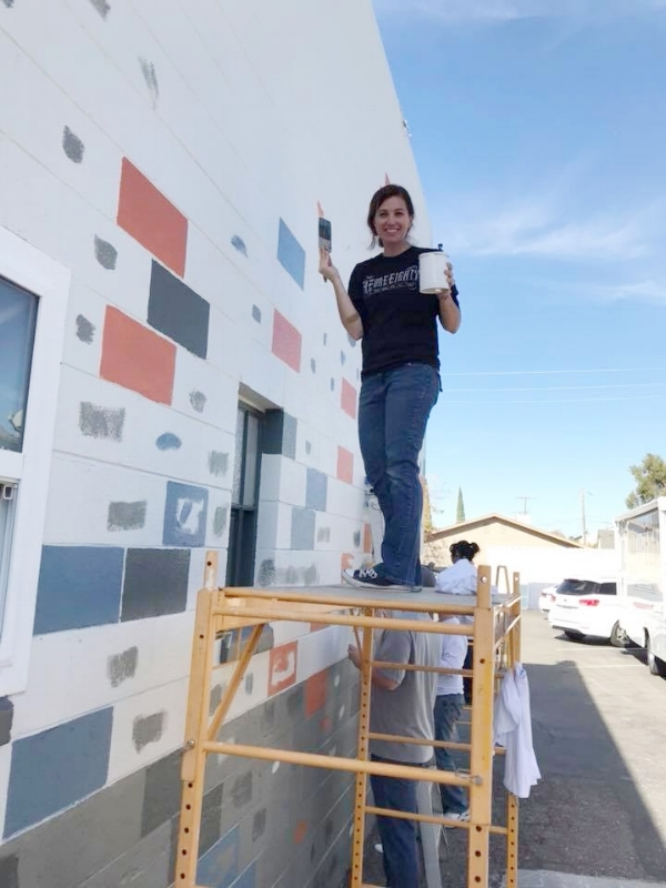 Alison McGregor painting the East wall of the One-Eighty