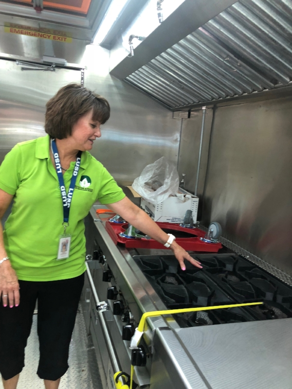 My mom, Susan, showing off the inside of their new food truck