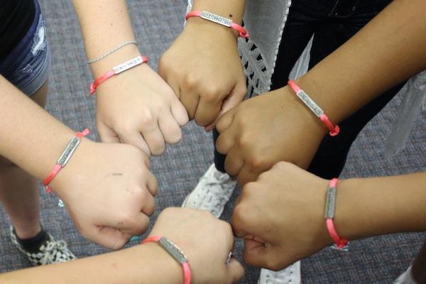 "The girls' ""Dream It, Be It"" bracelets. Picture compliments of Lodi Soroptimist."