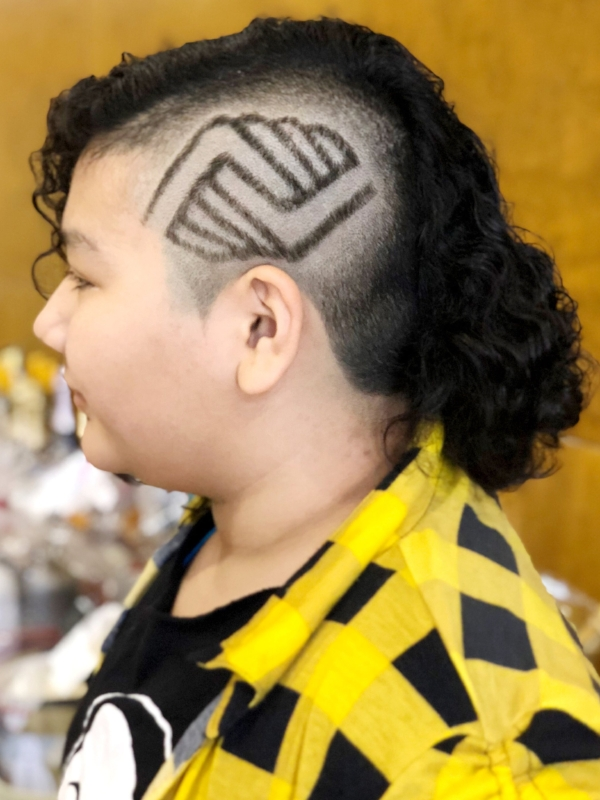 Sal's niece sports his impressive work with the Boys and Girls Club logo shaved into a fun hairstyle.