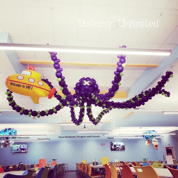 An underwater theme with a giant hanging balloon octopus
