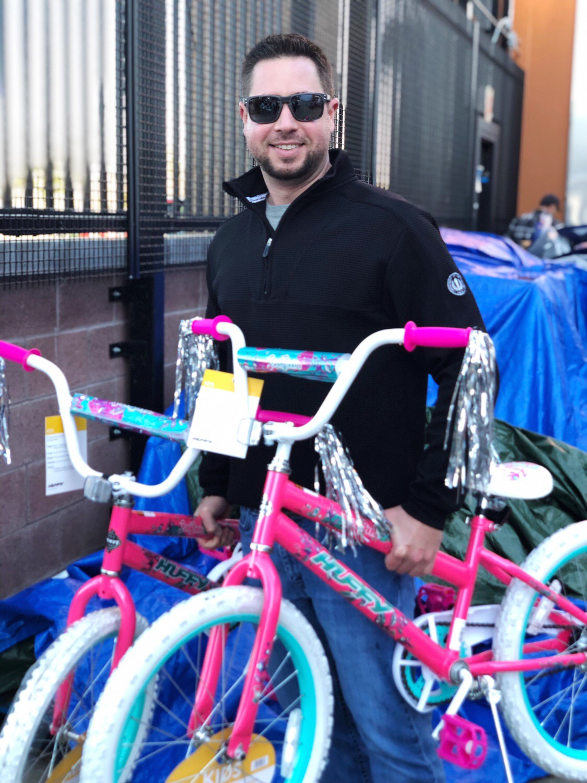 Aj Hohn, Rotary member, loading bikes