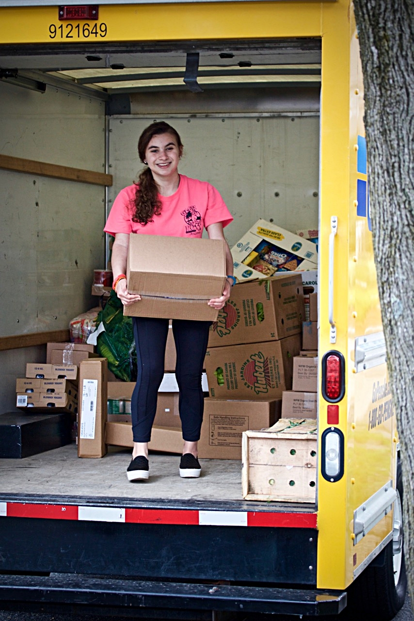 UNLOADING TRUCK OF DONATIONS