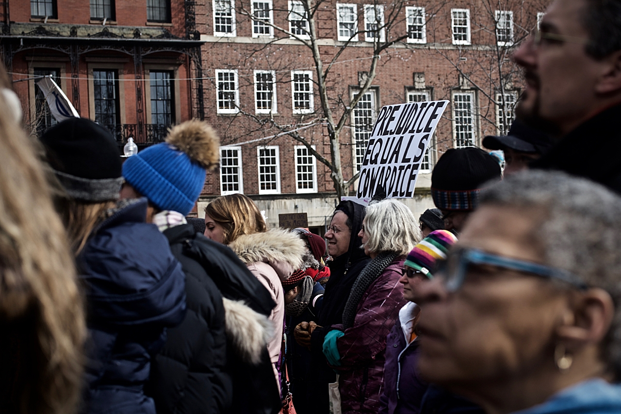 PREJUDICE EQUALS COWARDICE -  SIGN AT PROTEST