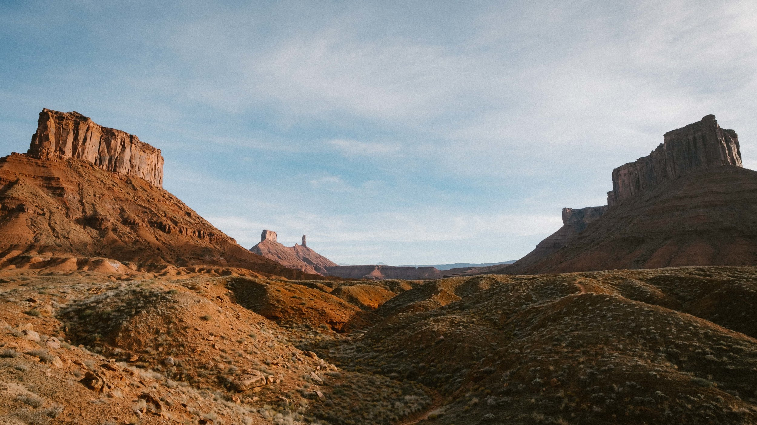 Views of Castleton Tower in the distance on the left and Parriott's Mesa on the right. Fuji XT-2, 14mm f/2.8 Lens