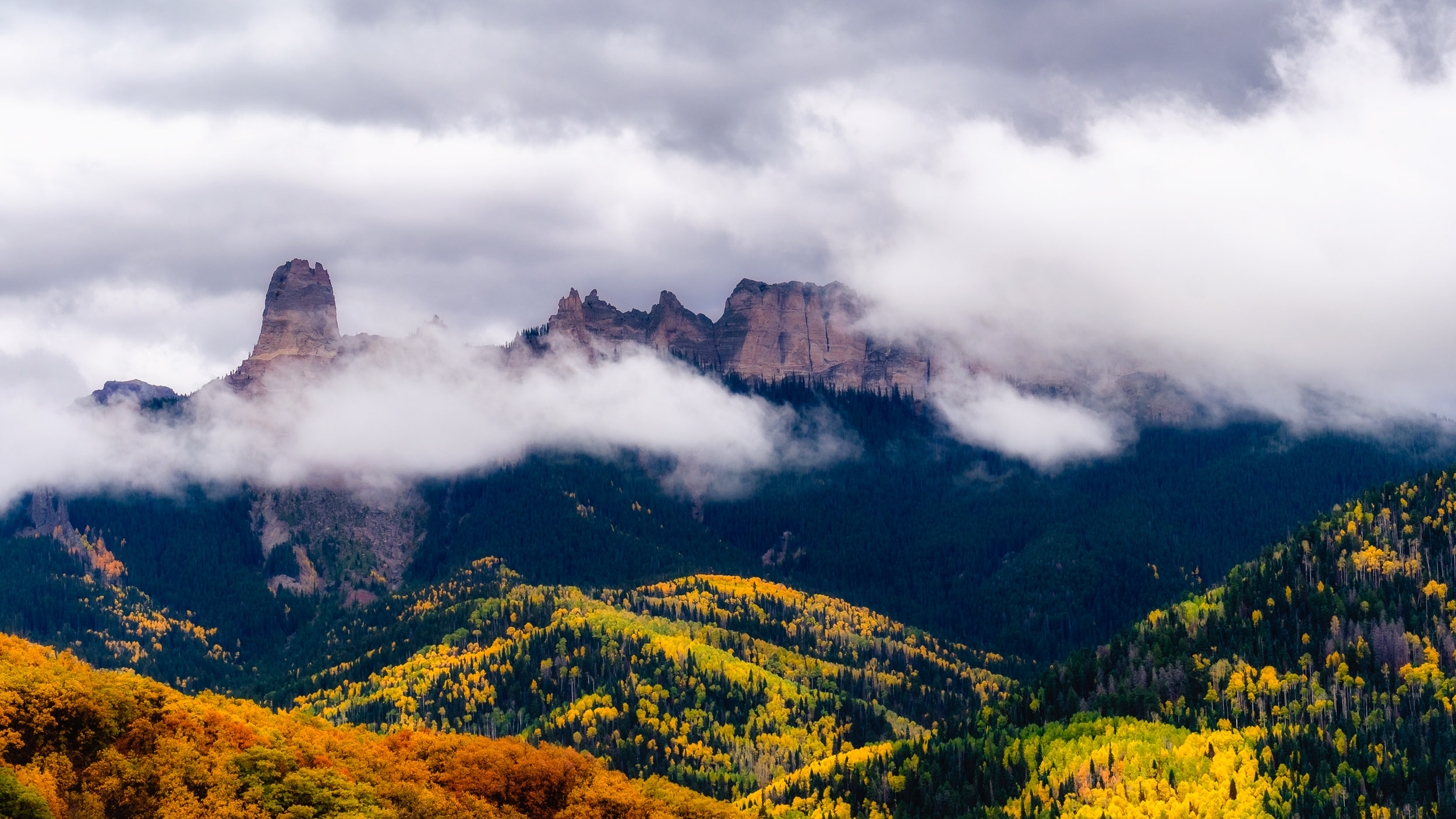 Storm clouds surround Chimney Rock and Courthouse Mountain along Owl Creek Pass in the Uncompahgre National Forest - Fuji XT2, XF 50-140mm f/2.8 @ 71.5mm
