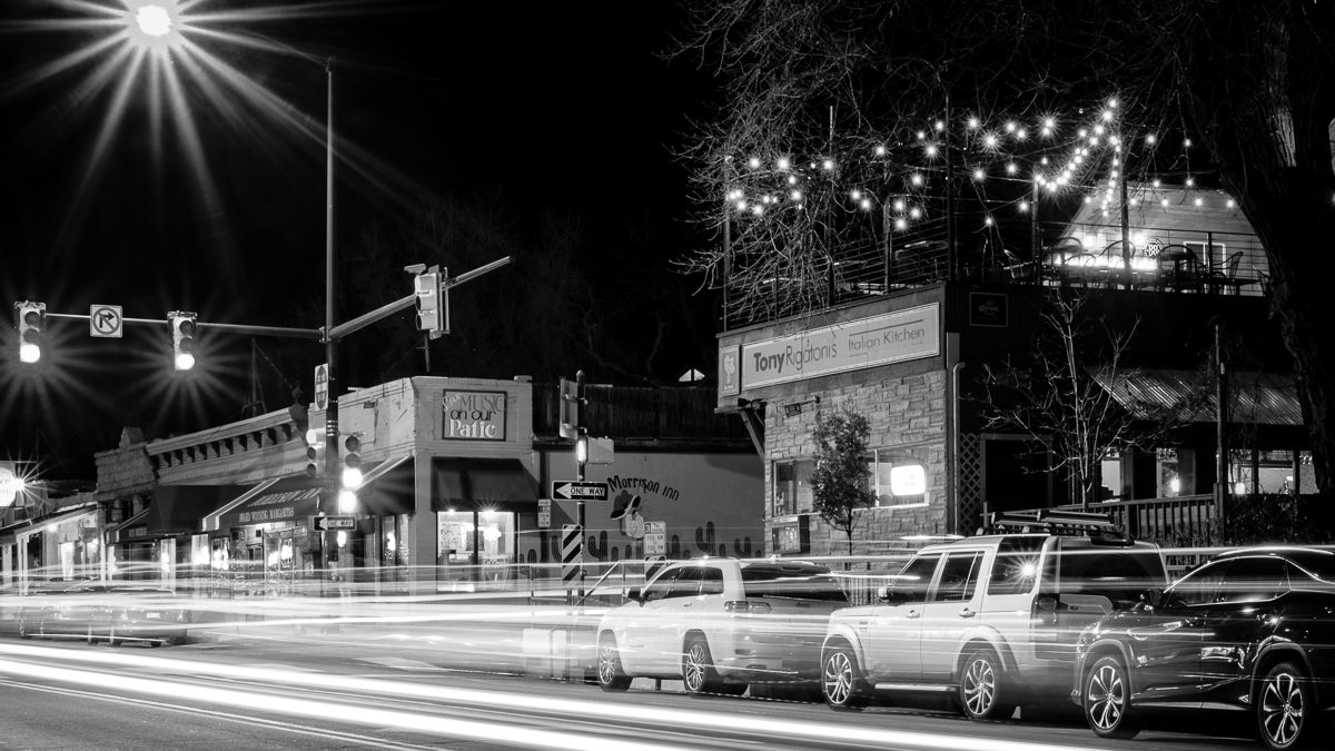 Day 11- 365 B&W Challenge - Morrison, Colorado is the gateway to Red Rocks Park. This is an image capturing the night lights in town viewing down the street toward Tony Rigatoni's and the Morrison Inn. The fire on the roof at Tony Rigatoni's was keeping customers warm. - Fuji XT-2, XF 23mm f/2, Acros R Film Simulation