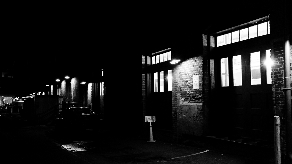 The windows and lampshades light the dark alleyways in Denver, Colorado