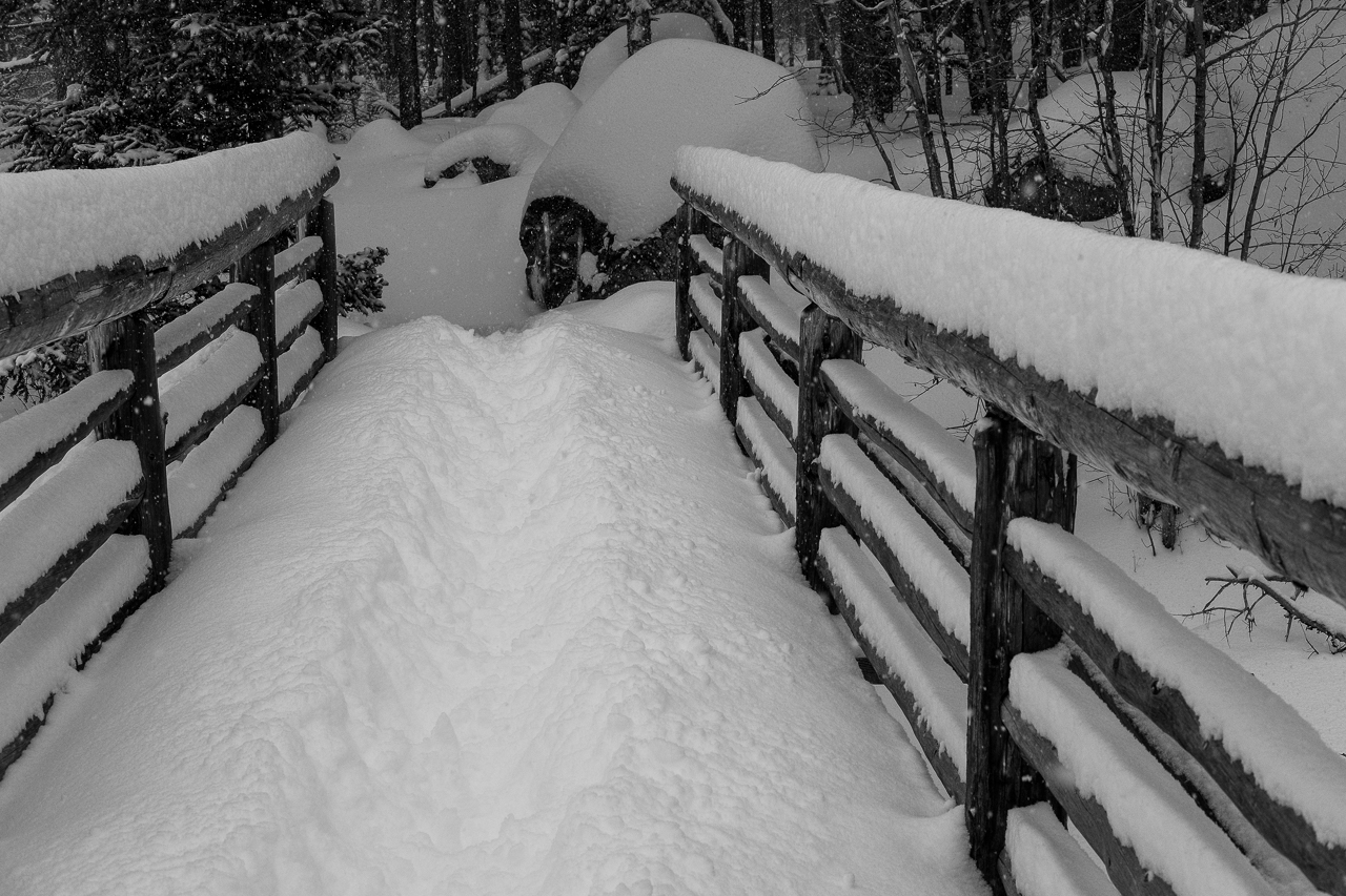 The trench throught the steep snow on the bridge across Glacier Creek