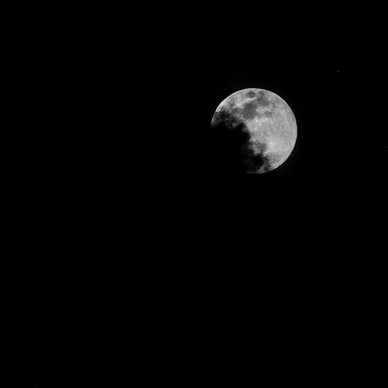Day 111 - 365 Day B&W Photo Challenge - The Moon last night was a Waxing gibbous at about 98% of a full moon. I took this image handheld as the clouds were passing over the face of the moon last night. - Fuji X-T2, XF 50-140mm f/2.8, Acros Film Simulation
