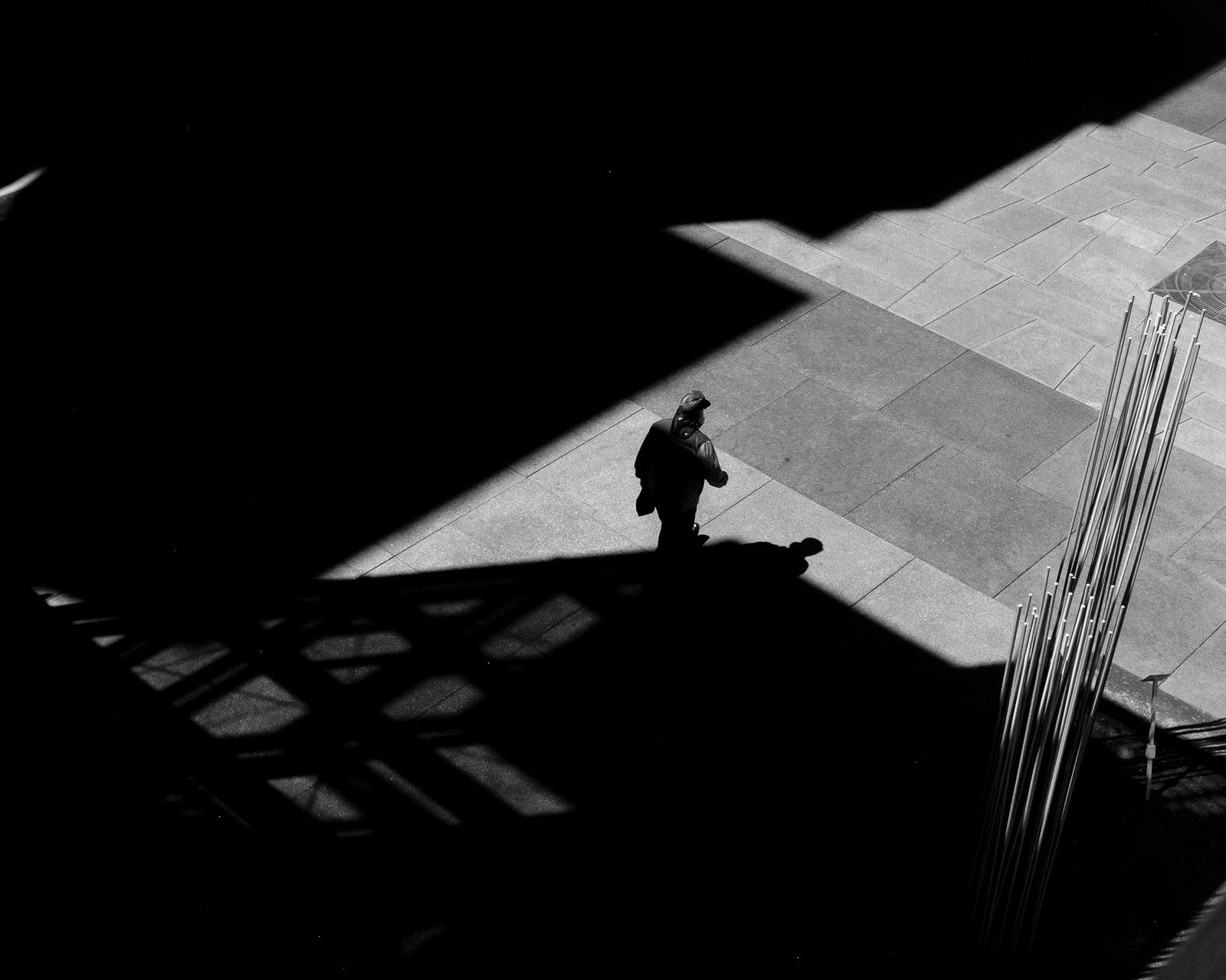 Day 133- 365 Day B&W Photo Challenge - A man walks out of the shadows below the Millenium Bridge in Denver, Colorado - Fuji X100F, Acros R Film Simulation