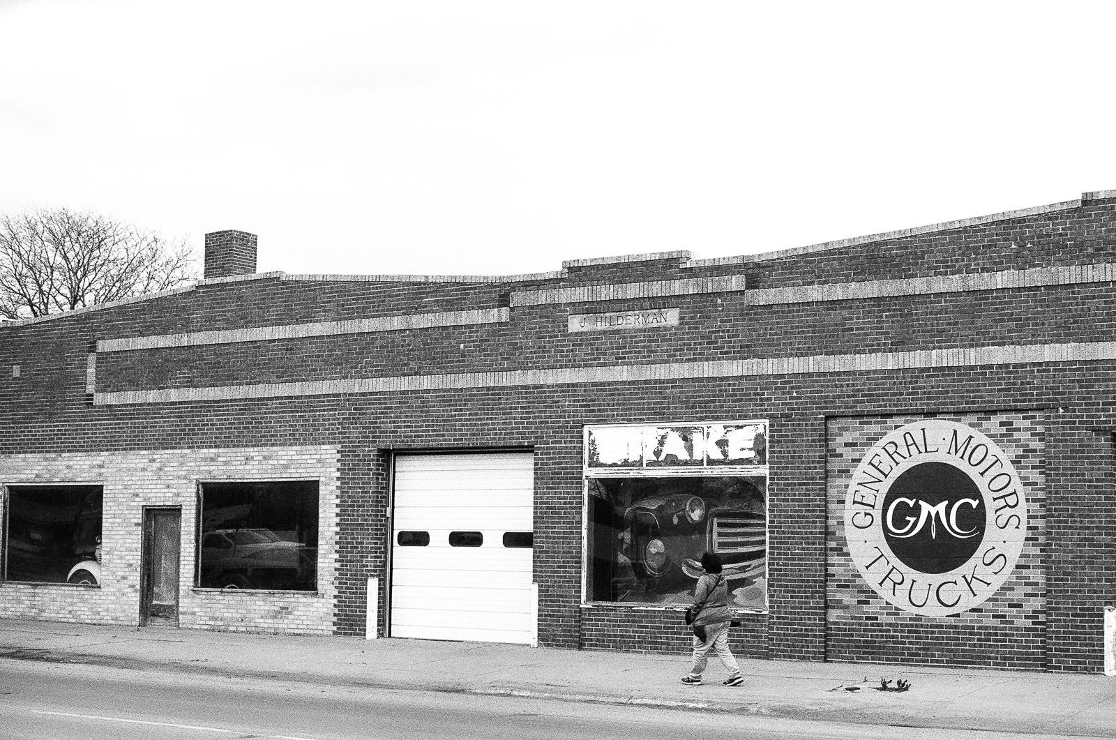 Day 138- 365 Day B&W Photo Challenge - The J. Hilderman GMC Truck Building in Sterling, Colorado. - Minolta X-700 using Ilford Delta HP5 black and white film pushed 1 stop.