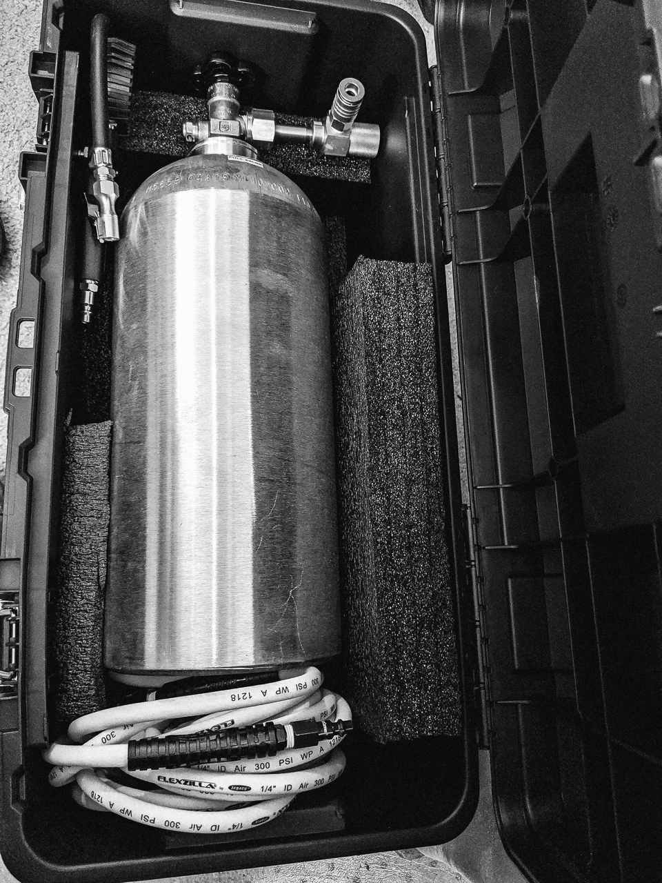 """Day 179 - 365 Day B&W Photo Challenge - My DIY """"Powertank"""" C02 Canister for airing up my off-road tires on the trail.  - Google Pixel 3, VSCO Kodak Tri-X400"""
