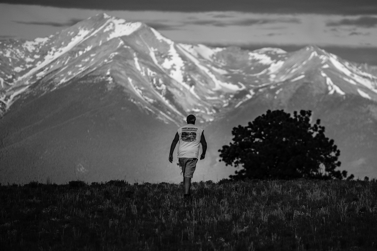 Day 190- 365 Day B&W Photo Challenge - The Mountains were calling Mike. I captured this image with a telephoto as Mike was walking toward the mountains to get a better phone image. - Fujifilm X-T3, XF 50-140mm f/2.8, Acros R Film Simulation
