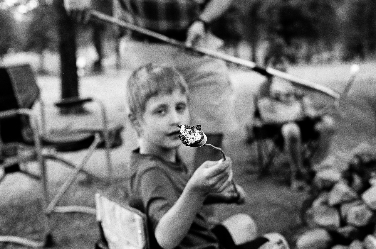 Day 191- 365 Day B&W Photo Challenge - A burnt marshmallow that was roasted over an open fire at camp. - Minolta X-700, Ilford HP5 Plus Film