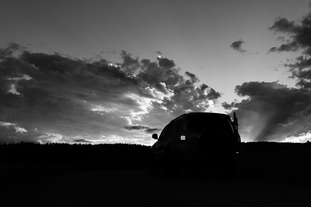 Day 199 - 365 Day B&W Photo Challenge - 4Runner silohetted against the sunset sky. - Fuji X-T3, XF 23mm f/2, Acros R Film Simulation