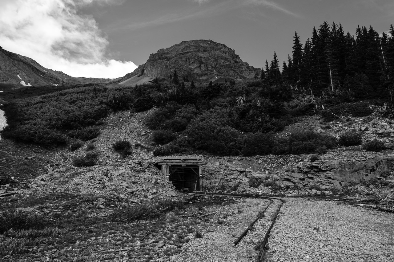 Day 235 - 365 Day B&W Photo Challenge - Rail tracks leading into an abandoned mine X-T3, XF14mm f/2.8, Acros G Film Simulation