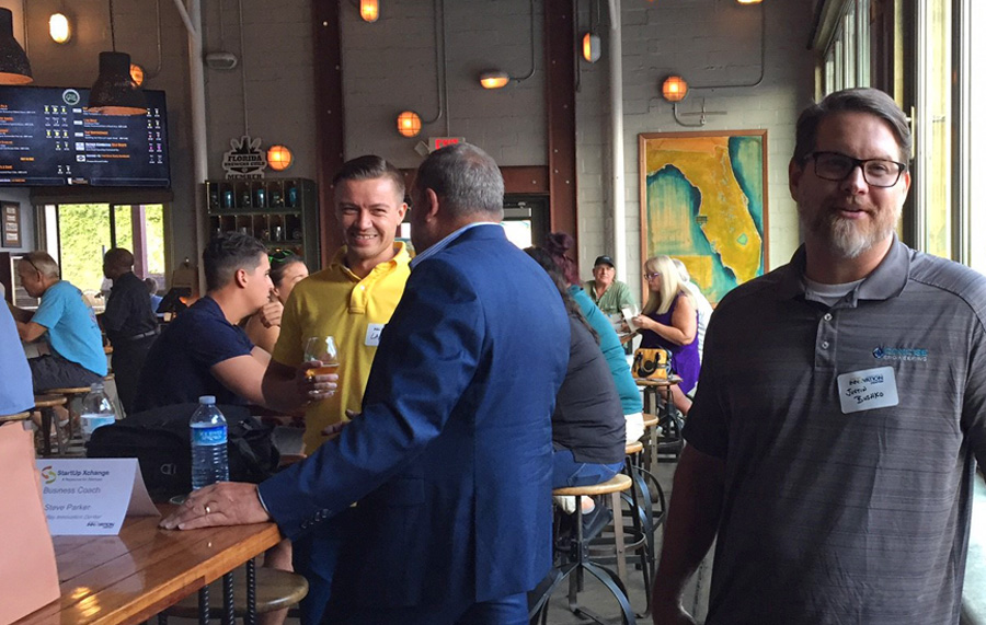 gathering of entrepreneurs at bar