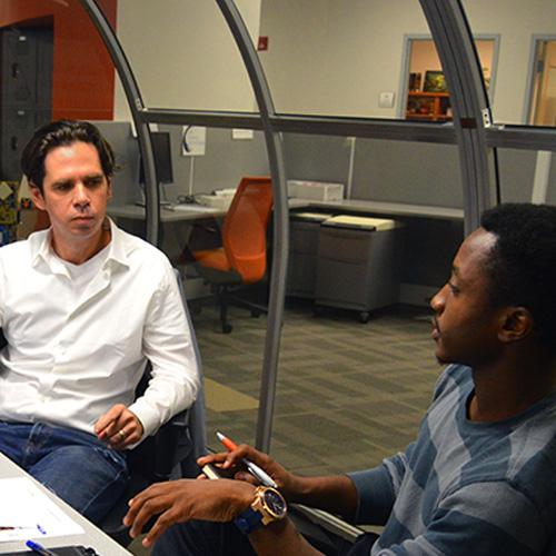 entrepreneurs sitting in conference room