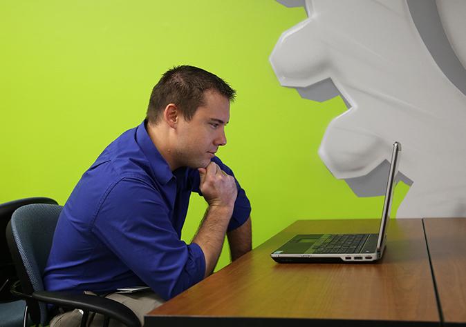 entrepreneur looking at laptop