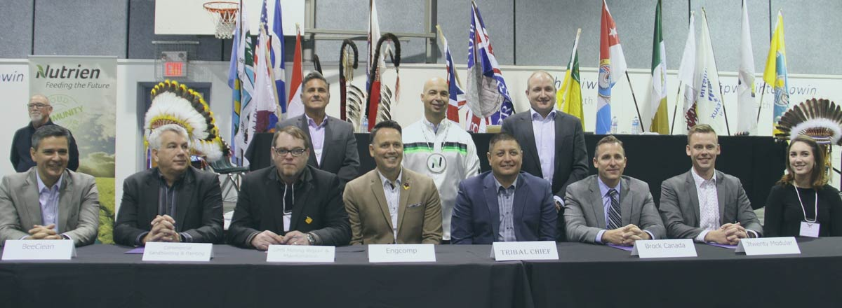 STC Legacy Partners seated in the front row with Engcomp President Jason Mewis and STC Tribal Chief Mark Arcand (centre)  Photograph Credit: John Lagimodiere, Eagle Feather News