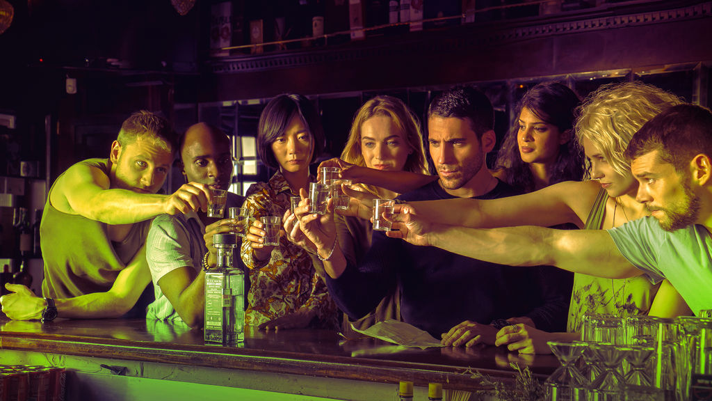 The empathically-linked cluster in  Sense8  shares a drink.