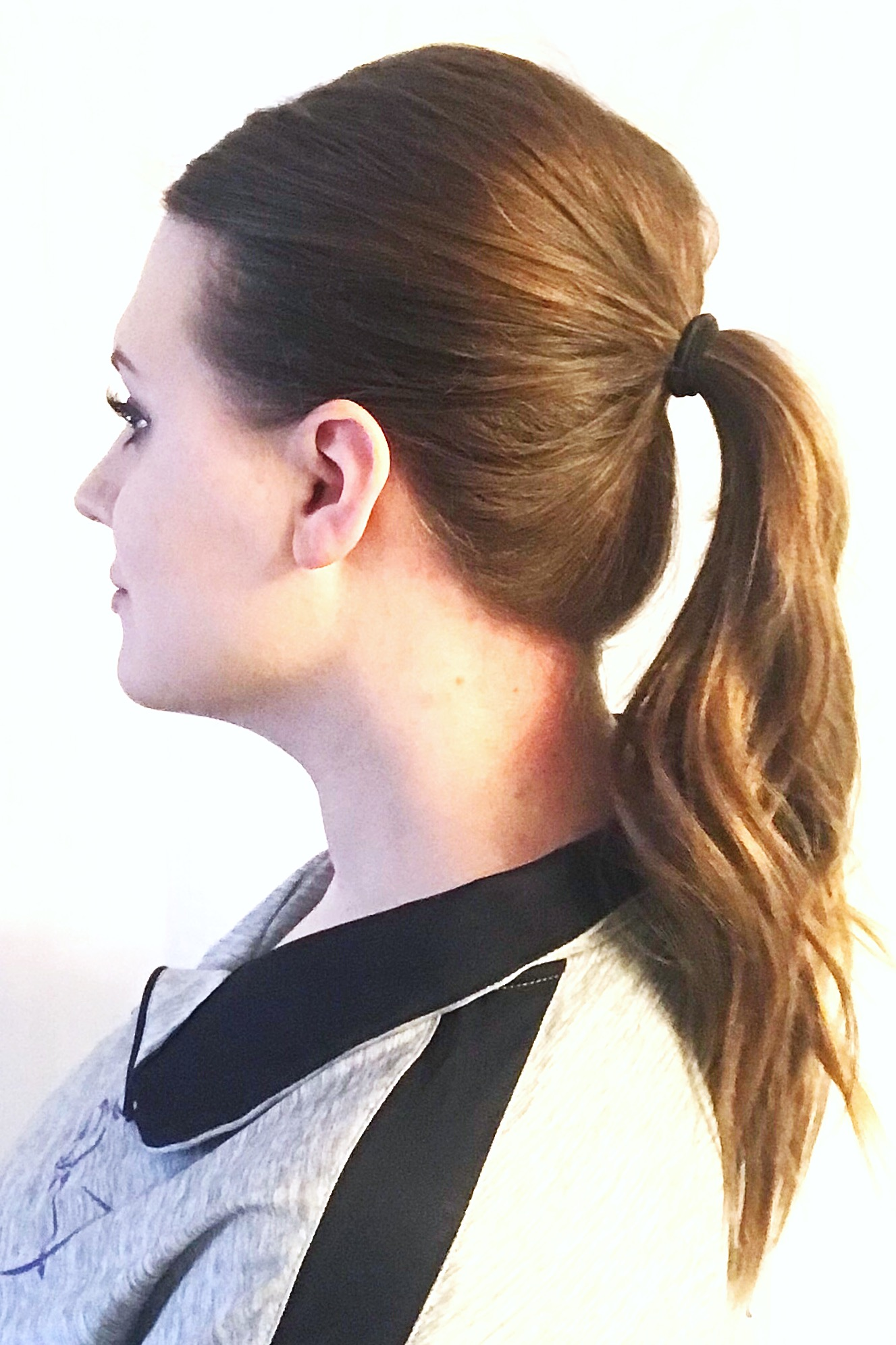 Next I put my hair into a mid-level ponytail. I like this style because I can usually put a ball cap on over it and don't have to adjust my ponytail height to fit through the hole. As you can see, the teasing added some nice volume on top. I keep my ponytails pretty tight as I find this helps keep the volume on the top of my head throughout the day.