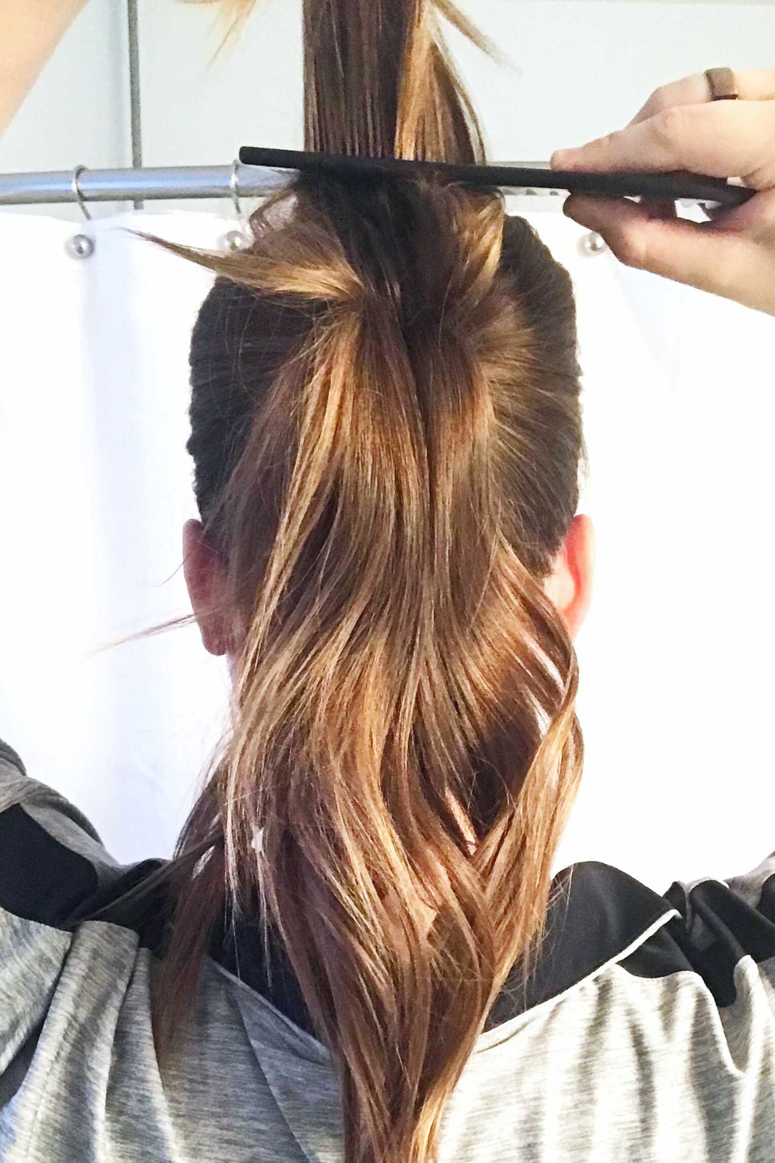 Then I take the top 1/3rd of my ponytail and tease that. After this I'll tease the bottom 2/3rds. This next trick is where the magic happens!