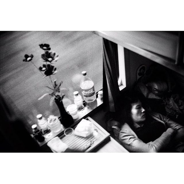 Waking up on the night train towards Ho Chi Minh. She was underneath the guy who offered to pay for my dinner as I couldn't bring any cash on that train journey since I couldn't find a working ATM. My bad the portrait I took of him was sooo underexposed I couldn't even scan it. SAD.  Somewhere in Vietnam. 2017. . . . . . #vietnam #asia #themiddlegrey #andthelastwaves #deathb4digital #instarevelat #back2thebase #afancl #leicam2 #40cron #35mmfilm #filmphotography #filmsnotdead #filmphotographic #buyfilmnotmegapixels #ilford #ilfordhp5