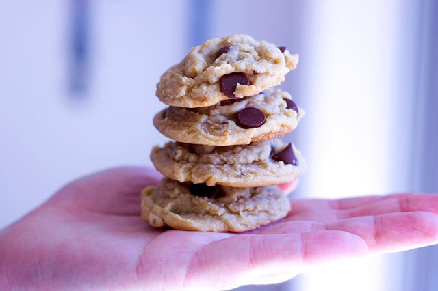 Stacks on stacks of mini chocolate chip cookies. Craving some? You can order the bundle on our website now! CaycakesBakery.com 🍪
