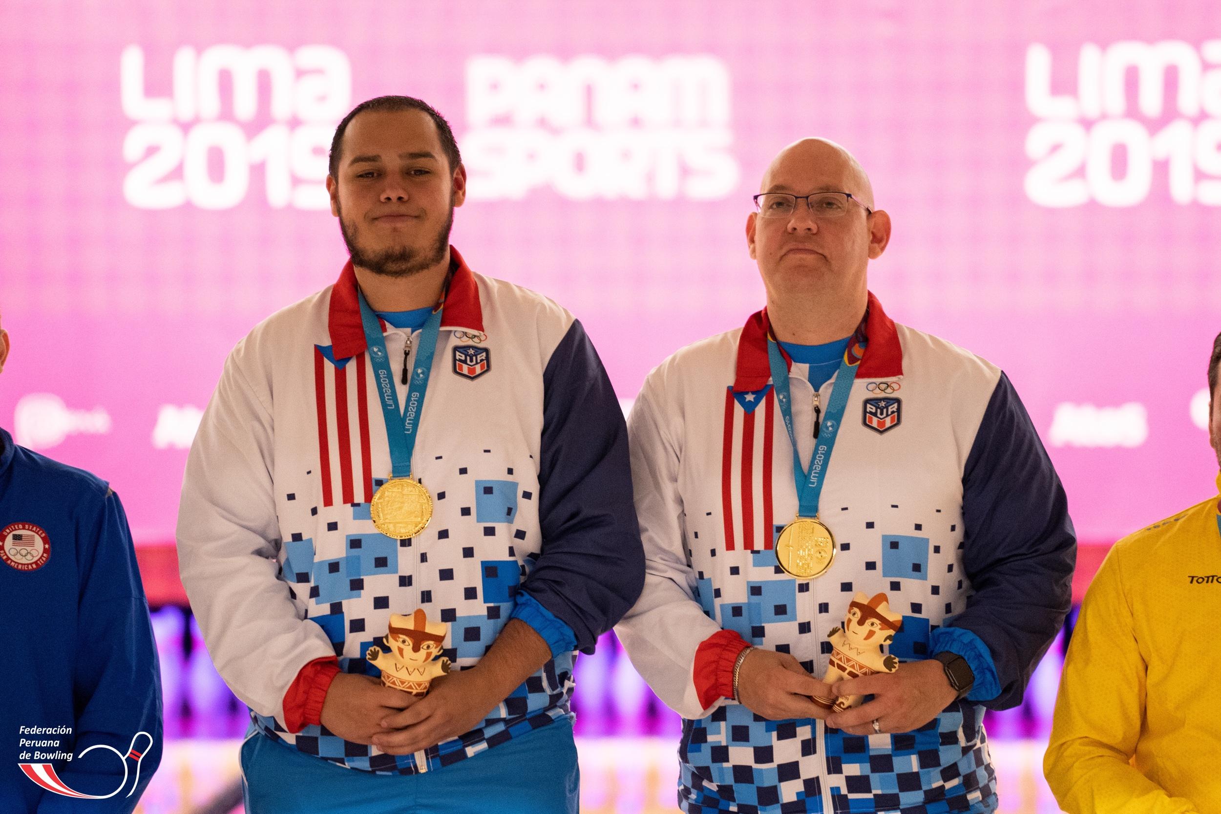 Cristian Azcona y Jean Francisco Perez (Puerto Rico). Campeones en la modalidad dobles con 5816 palos derribados, Récord Panamericano.
