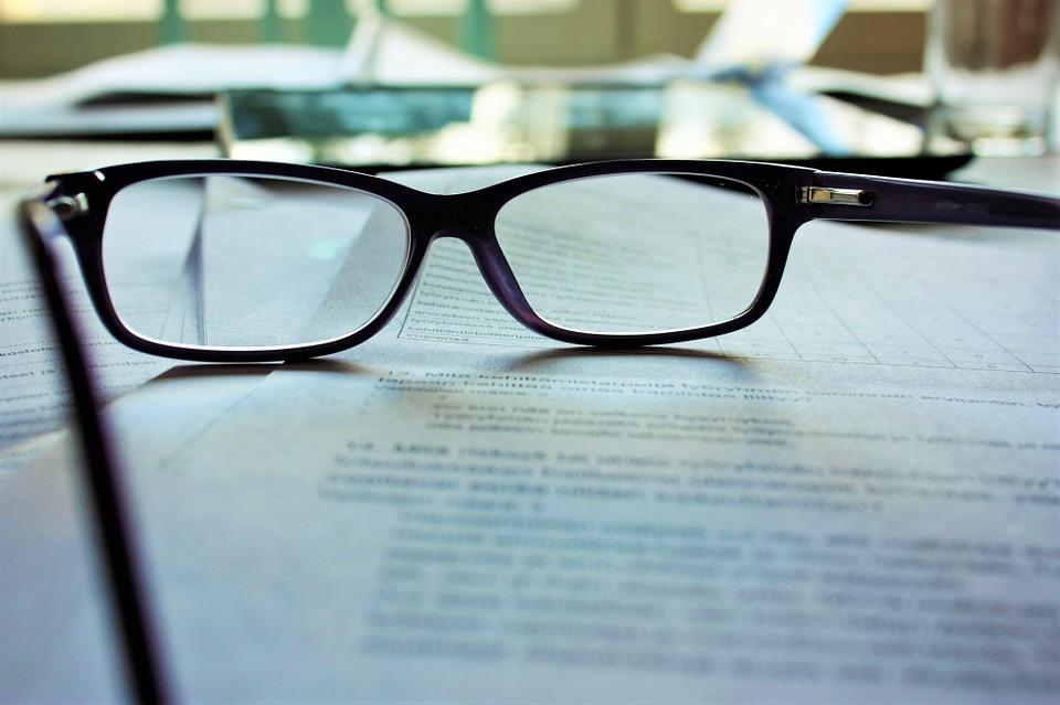 Eyeglasses on work paper