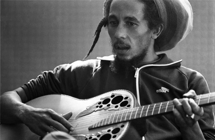 bob marley playing guitar.jpg