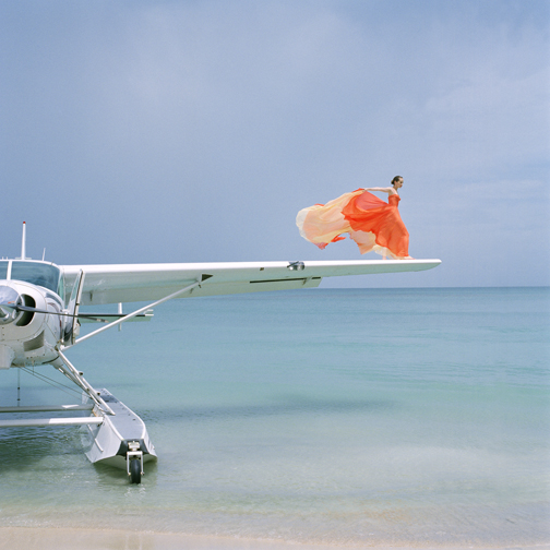 Saori on sea plane wing by Rodney Smith  Available in 4 sizes  Price from 10000 USD