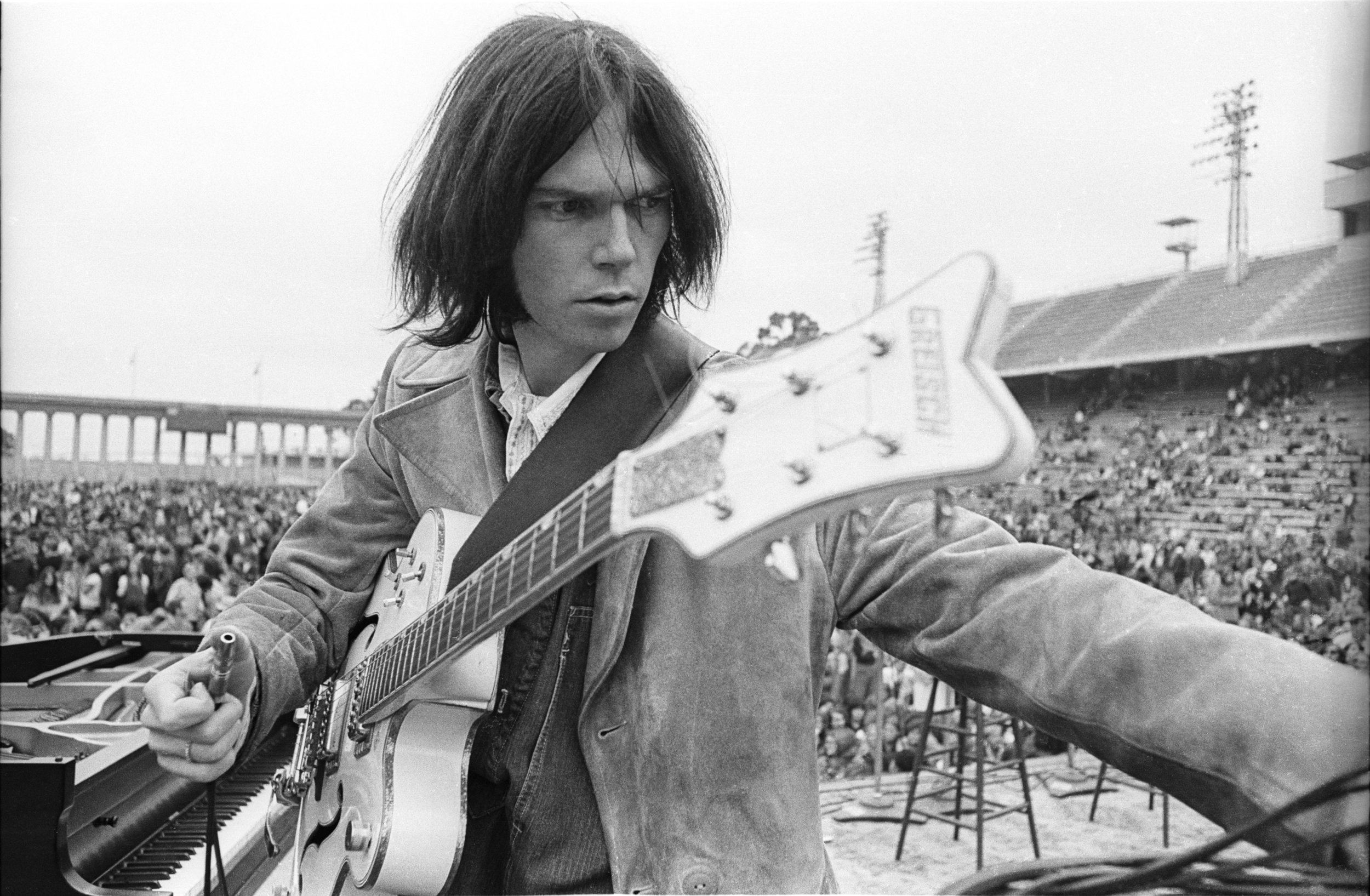 Neil Young, 'White Falcon,' Balboa Stadium, San Diego, CA 1969 by Henry Diltz