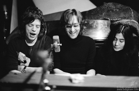 Mick Jagger of The Rolling Stones, John Lennon and Yoko Ono singing at a piano at The Record Plant, NYC. October 1972 by Bob Gruen